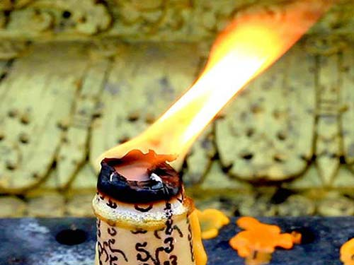 Burning candle in a temple.