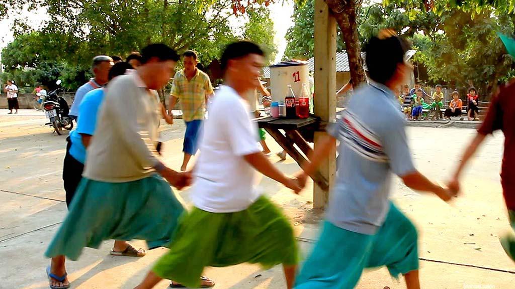 Men dancing in the Lisu New Year Celebration.