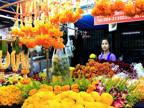 Stall of flowers in a market, for offerings.