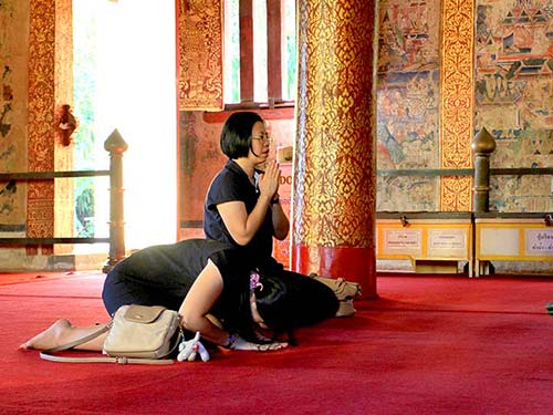 Women praying in a temple, Wat Phra Singh, Chiang Mai.